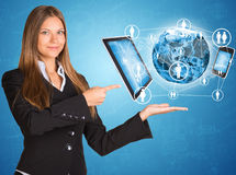 Businesswoman in suit. Earth and electronics Royalty Free Stock Photo