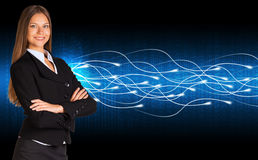 Businesswoman in a suit and glow rays Royalty Free Stock Photos