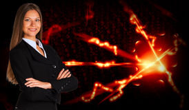 Businesswoman in a suit and glow rays Stock Photos