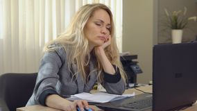 Businesswoman in suit having a nap just right on laptop keyboard after work. Businesswoman in suit having a nap just right on laptop keyboard after work stock video footage