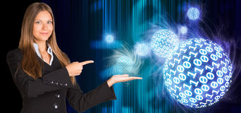 Businesswoman in suit hold spheres of glowing Stock Images