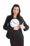 Businesswoman in suit holding a clock Royalty Free Stock Photography