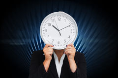 Businesswoman in suit holding a clock Royalty Free Stock Photo