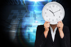 Businesswoman in suit holding a clock Royalty Free Stock Images