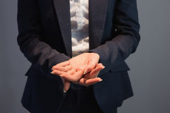 Businesswoman in suit holding her hands out Stock Photo