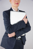 Businesswoman in suit holding laptop Stock Images