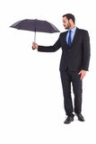 Businesswoman in suit holding umbrella Stock Photography