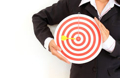 Businesswoman in a suit holds a dart board Royalty Free Stock Photography