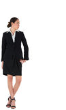 Businesswoman in suit looking to the side. On white background Stock Photo