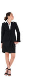 Businesswoman in suit looking to the side. On white background Royalty Free Stock Image