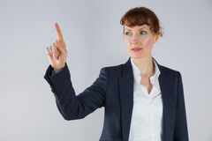 Businesswoman in suit pointing finger Stock Photo