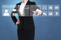 Businesswoman in suit pointing finger to app menu Stock Photo