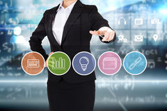 Businesswoman in suit pointing finger to business app buttons Royalty Free Stock Image