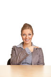 Businesswoman in suit pointing hand Stock Photography