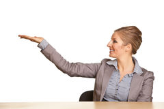Businesswoman in suit pointing hand Royalty Free Stock Images