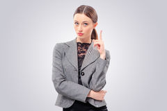 Businesswoman in suit pointing up Royalty Free Stock Photography