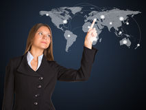 Businesswoman in a suit presses the virtual world Royalty Free Stock Photo