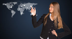 Businesswoman in a suit presses the virtual world Royalty Free Stock Images
