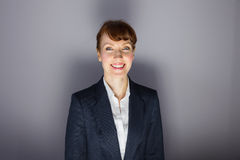 Businesswoman in suit smiling at camera Royalty Free Stock Photos