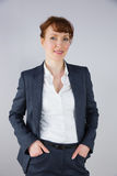 Businesswoman in suit smiling at camera Stock Photos