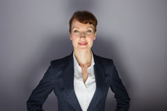 Businesswoman in suit smiling at camera Stock Photography