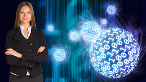 Businesswoman in a suit. Spheres of glowing digits Royalty Free Stock Images