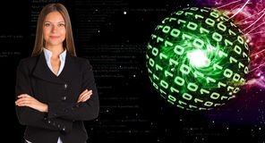 Businesswoman in a suit. Spheres of glowing digits Royalty Free Stock Photography