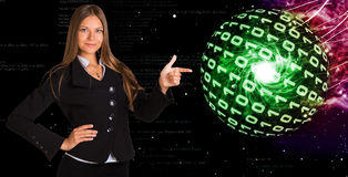 Businesswoman in a suit. Spheres of glowing digits Stock Photo