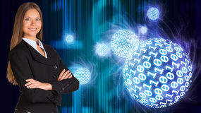 Businesswoman in a suit. Spheres of glowing digits Royalty Free Stock Image