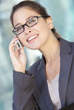 Businesswoman in Suit and Talking on Cell Phone Royalty Free Stock Photos