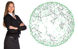 Businesswoman in a suit with wire frame sphere Royalty Free Stock Photos