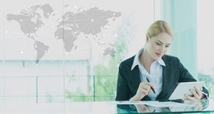 Businesswoman in suit working with report, business globalizatio Stock Image