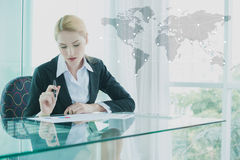 Businesswoman in suit working with report, business globalizatio Stock Photo