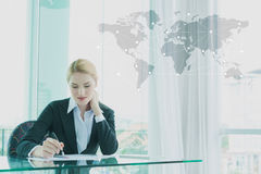 Businesswoman in suit working with report, business globalizatio Royalty Free Stock Photo