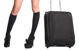 Businesswoman and suitcase. Businesswoman s legs in high stockings and high heels, holding a black suitcase Stock Images