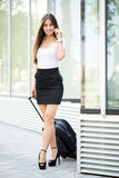 Businesswoman with suitcase Stock Photography