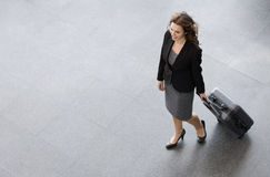 A businesswoman and suitcase royalty free stock photography