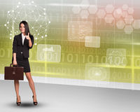 Businesswoman with suitcase on abstract background Stock Photography