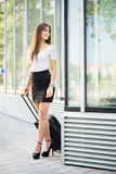 Businesswoman with suitcase Royalty Free Stock Photo