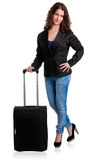 Businesswoman and suitcase. Businesswoman dressing smart casual clothes, holding a black suitcase, isolated in white Royalty Free Stock Photography
