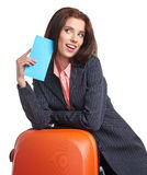 Businesswoman with a suitcase and a ticket Stock Photography