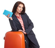 Businesswoman with a suitcase and a ticket Royalty Free Stock Image
