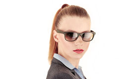 Businesswoman with sunglasses on. Red haired caucasian businesswoman with a ponytail,suit and sunglasses on. Very crisp photo Royalty Free Stock Photography