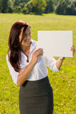 Businesswoman sunny meadow look at empty banner Stock Image