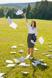 Businesswoman sunny meadow throw papers freedom. Young businesswoman sunny meadows attractive smiling throw papers freedom stock photo