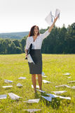 Businesswoman sunny meadow throw papers freedom Stock Image