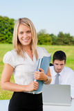 Businesswoman in sunny nature with folders smile Royalty Free Stock Photo