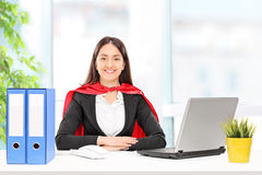 Businesswoman in superhero costume Stock Images