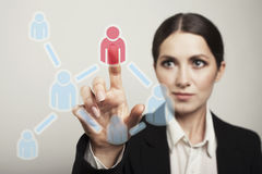 Businesswoman supports social network on futuristic screen Stock Photography