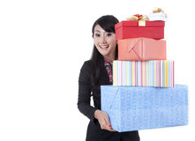 Businesswoman with a surprised gifts. Asian businesswoman carries stack of christmas gift Stock Photography